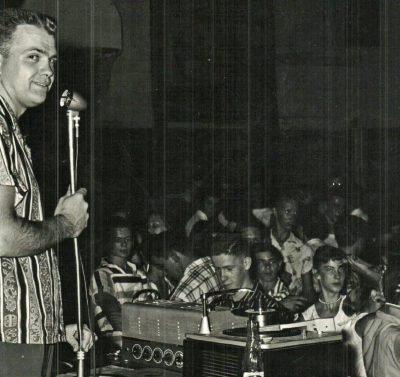 A disc jockey spins the records at Teen-Inn, overseen by Jack and Marge McCash who were the adult advisors to Teen-Inn during the 1950s and 1960s.